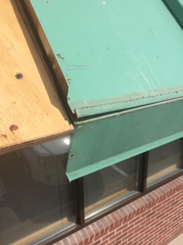 Metal_Roof_Repair.jpg