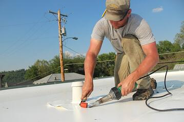 Metal_roof_repair_air_vets.jpg
