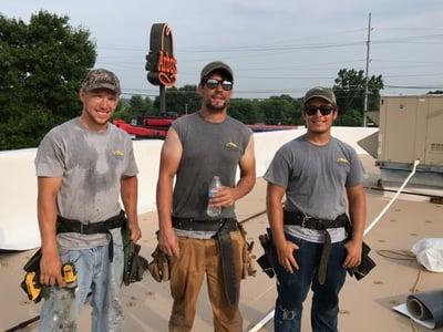 Working Men TPO Flat Roof Repair.jpg