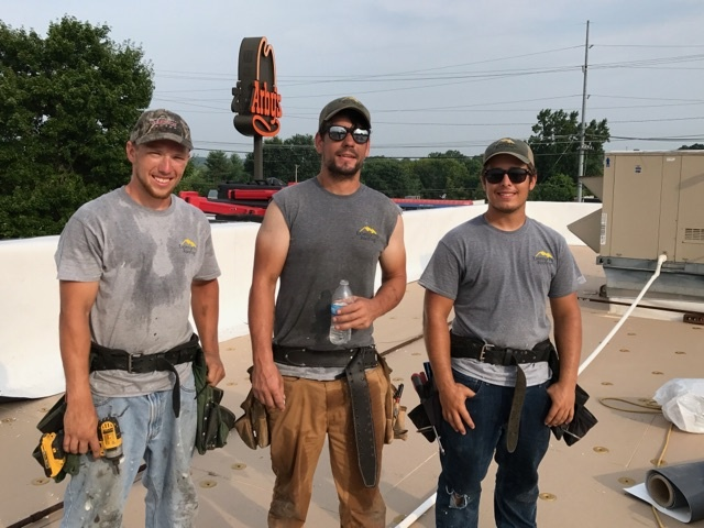 Working Men TPO Flat Roof Repair.jpg
