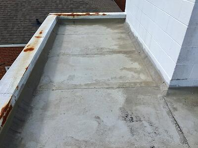 Flat Roof Repair Damage 2- First Baptist Church.jpg