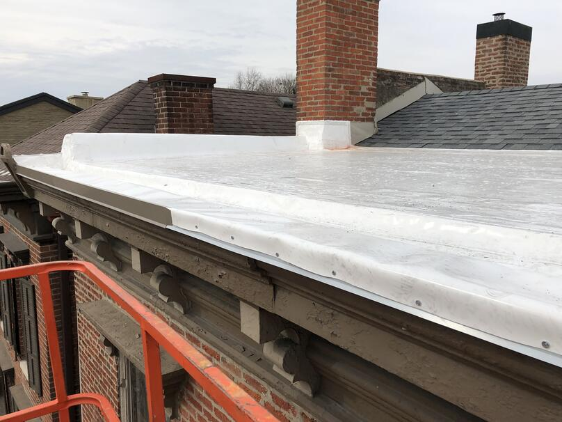 Downtown Madison In Flat Roof And Gutter Installation