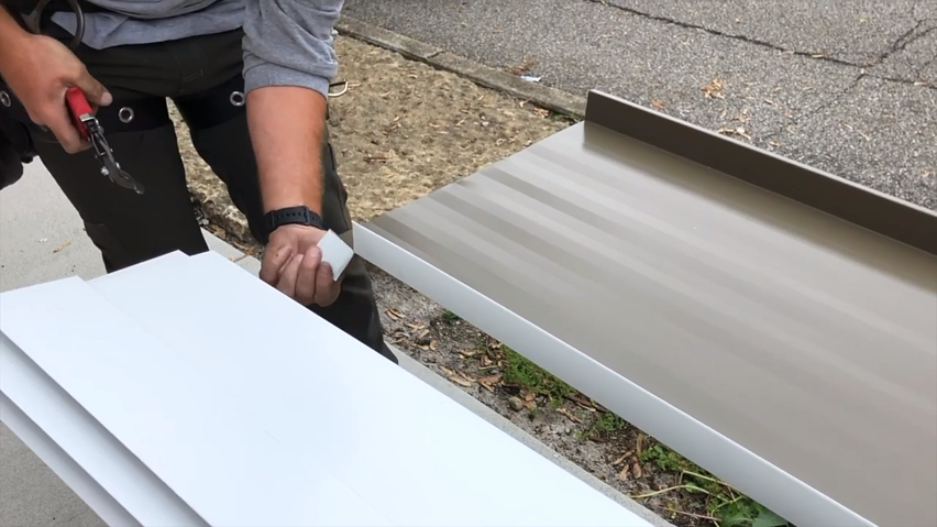 Custom trims for standing seam metal roofs