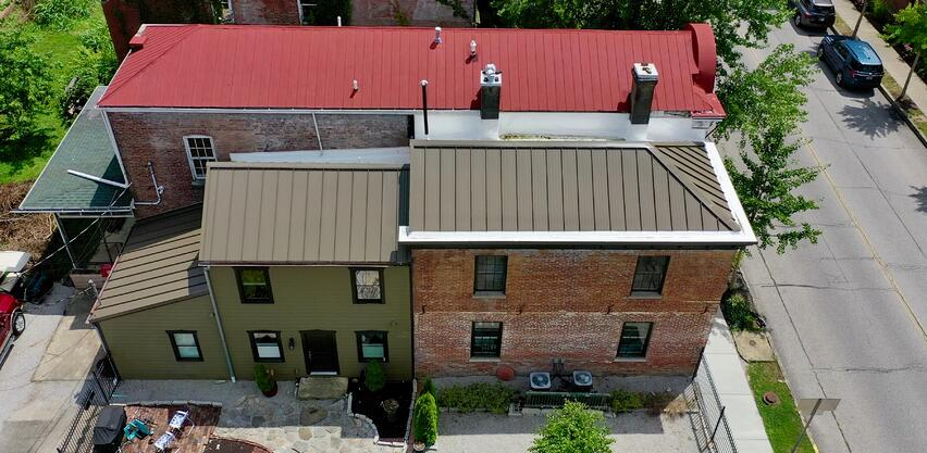 standing seam metal roof with box gutters