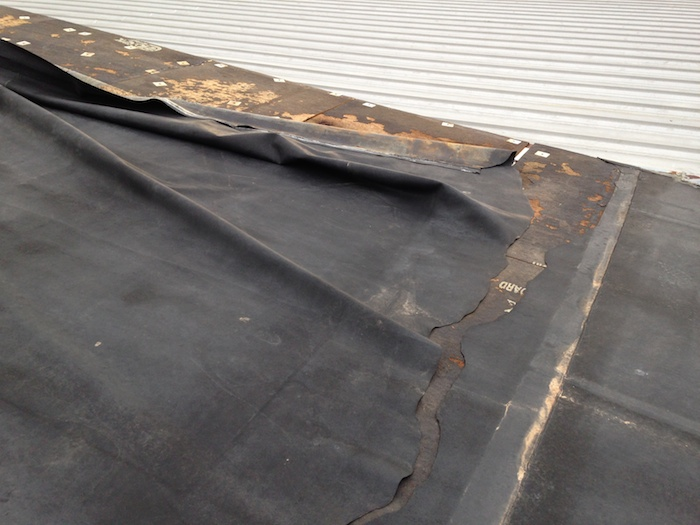 Addressing Wind Damage For Flat Commercial Roofs
